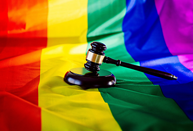 rainbow flag with gavel - symbol of law